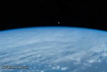 Moon Sets Behind Earth!